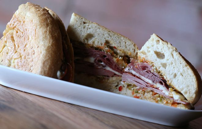 Toutant's muffaletta is a French Quarter specialty of cured meats, cheese and olive salad on a fresh baked garlic loaf. (Sharon Cantillon/Buffalo News file photo)