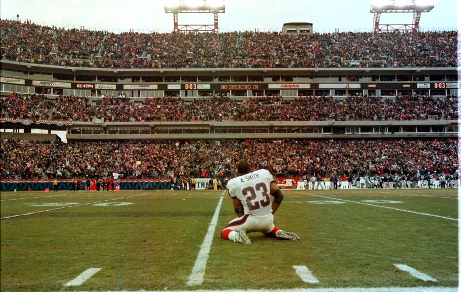 """Bills running back Antowain Smith dropped to the field in disbelief after the Tennessee Titans pulled off the """"Music City Miracle"""" on Jan. 8, 2000."""