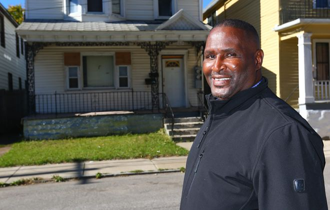 East Side real estate investor Larry Lamb has amassed a portfolio of 12 homes via foreclosure auctions since 1995.
