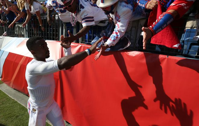 Buffalo Bills quarterback Tyrod Taylor (5) celebrates with the fans after the win against the Tennessee Titans at Nissan Stadium in Nashville.  (James P. McCoy/ Buffalo News)