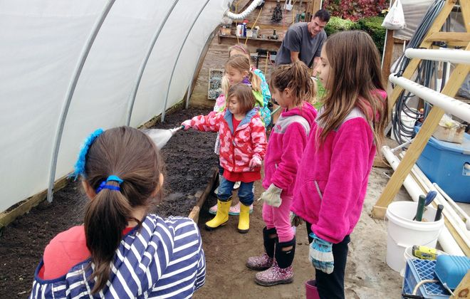 Laura Yusick of Orchard Park started a kids' volunteer group, The Little Leaguers, to expose kids to service activities at an early age. Here the kids help out at an urban farm run by the Buffalo Community Action Organization.