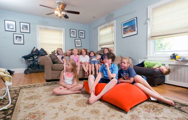 The Sheehan kids, who number nine total, often spend time with their cousins, the Kooshoians, who live in the same North Buffalo neighborhood. Pictured are Clare, Maeve, Meghan, Tommy, Patrick, Molly and Luke Sheehan and Katie, Peter, Lizzie and Daniel Kooshoian. (Michael P. Majewski)