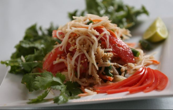 Cozy Thai's papaya salad consists of shredded green papaya, carrots, tomatoes, green beans, chiles, garlic, lime juice, palm sugar and topped with ground peanuts. (Sharon Cantillon/Buffalo News)