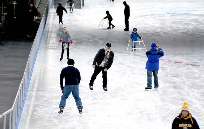 A range of ages enjoys The Ice at Canalside on Monday as the season begins with new features such as Winter Pavilion and more-spacious warming hut.