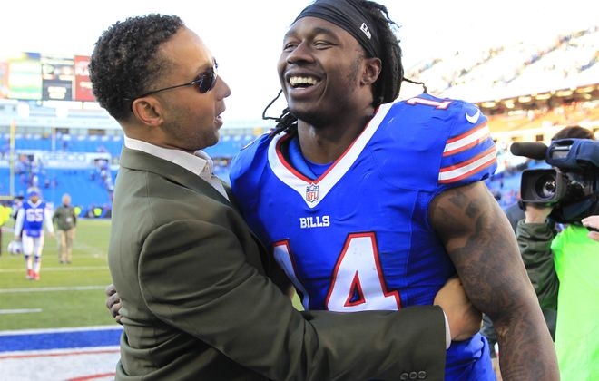 Bills general manager greets Sammy Watkins after the wide receiver's outstanding performance in the win over the Dolphins. (Harry Scull Jr./Buffalo News)