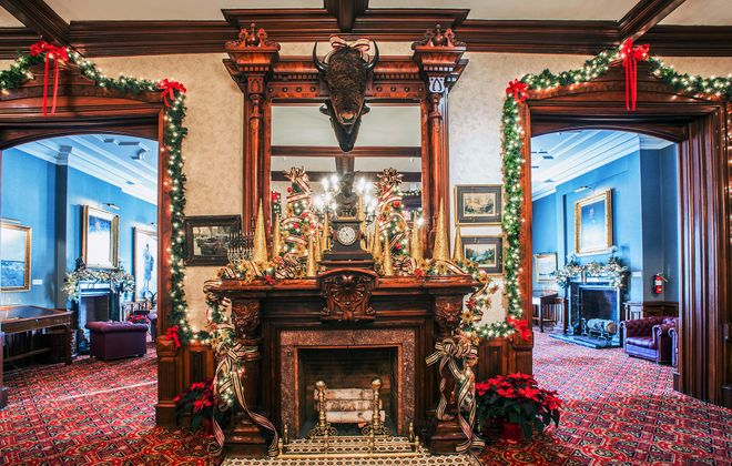 At the Buffalo Club, decorator/florist Maureen Bartley incorporates traditional holiday trimmings to complement the refined, classic décor.  (Michael P. Majewski)