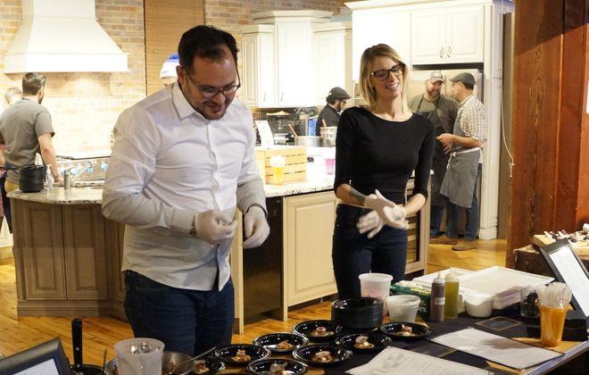 Edward Forster and Jessica Railey, two partners in planned venture, serve Buffalo Proper's apple-gouda-turnip bite in 2015. (Photo: Nick Guy)