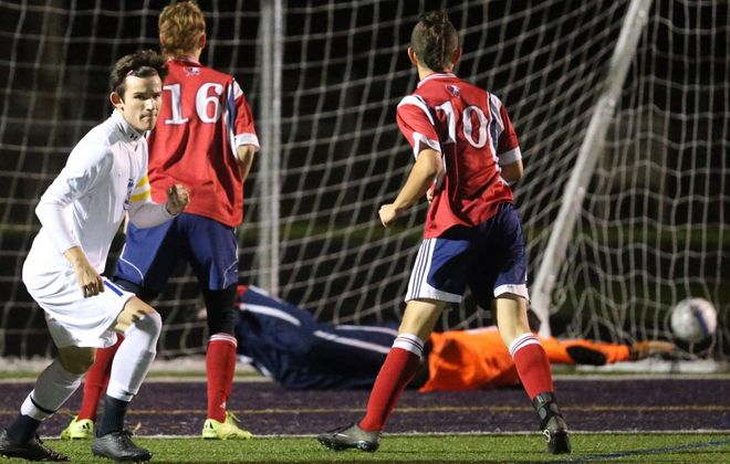 Troy Brady, far left in white, scores against Iroquois in the sectional playoffs in 2015. (James P. McCoy/Buffalo News file photo)