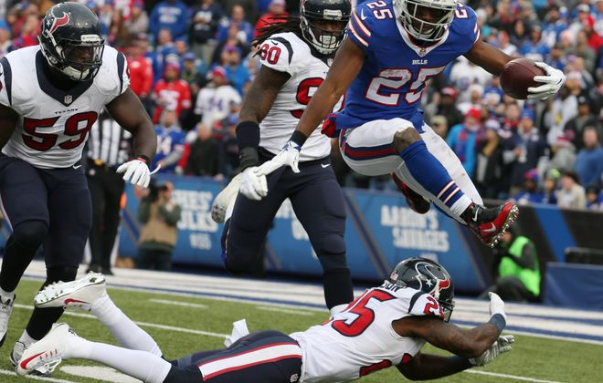 1LINE CUTLINE Buffalo Bills running back LeSean McCoy leaps over Houston Texans cornerback Johnathan Joseph during the third quarter at Ralph Wilson Stadium in Orchard Park, N.Y. on Sunday, Dec. 6, 2015.  (James P. McCoy/ Buffalo News)