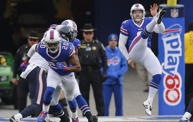 2LINE CUTLINE Buffalo Bills' Colton Schmidt watchs his punt in the second quarter at Ralph Wilson Stadium in Orchard Park, Sunday, Dec. 6, 2015.  (Mark Mulville/Buffalo News)