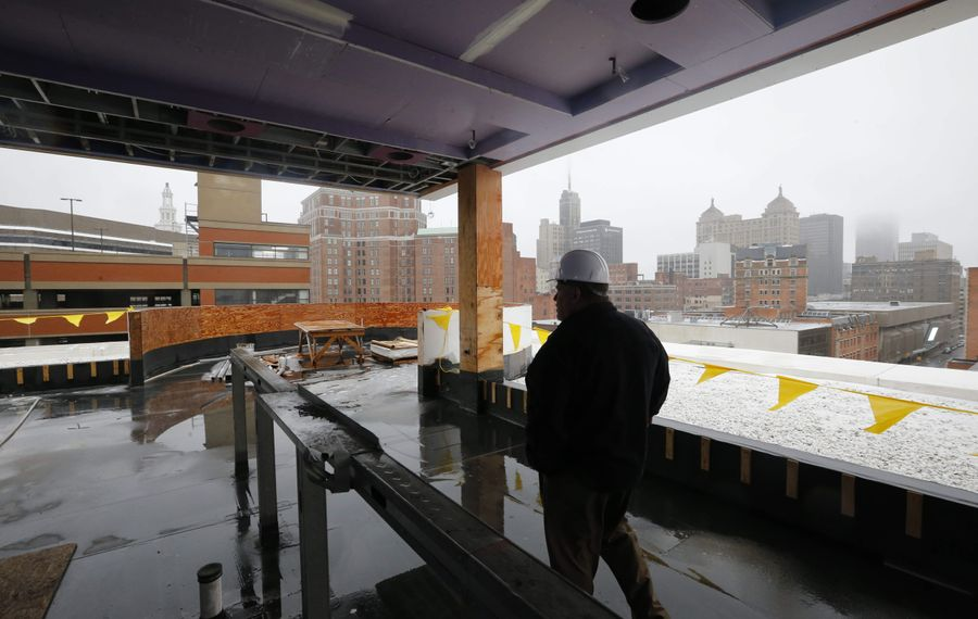 Developer Mark Croce surveys progress of the rooftop lounge at the Curtiss Hotel.
