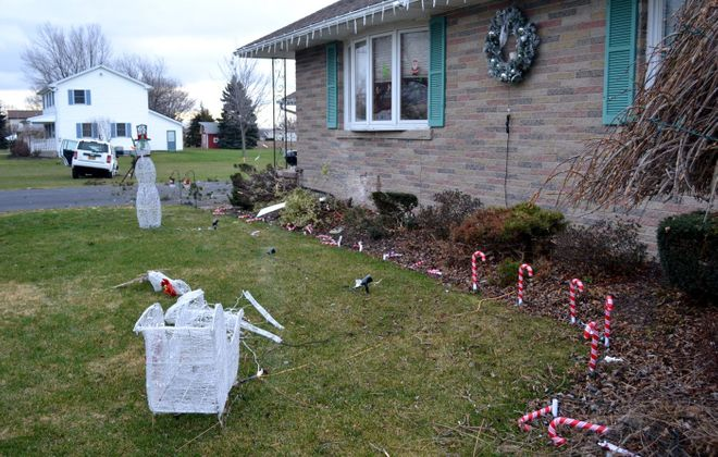 A car crashed into a home on Saunders-Settlement Road in Lewiston on Dec. 28. (Larry Kensinger/Contributor)