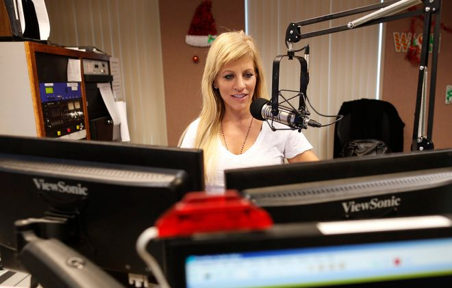 Janet Snyder hosts the morning show at Kiss 98.5 in the Entercom studio in Amherst. (Derek Gee/News file photo)
