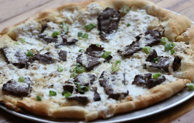The beef and weck pizza from Hydraulic Hearth is made with grilled strip steak, horseradish sauce, kimmelweck crust and mozzarella. (Sharon Cantillon/Buffalo News)