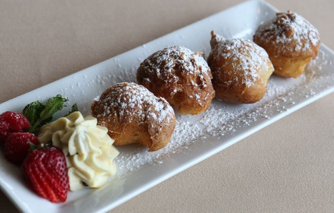 Sfinge is a popular dessert for St. Joseph's Day. This is Gigi's Cucina Povera's creation. (Sharon Cantillon/Buffalo News file photo)
