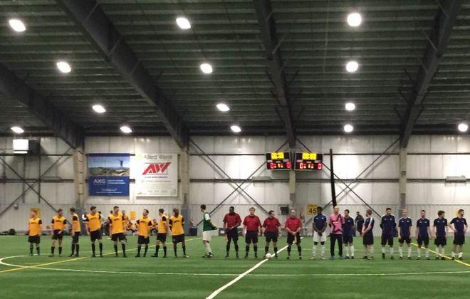 The BSC Raiders, in yellow, line up before their match against Italian-Americans SC from the Rochester District Soccer League. (Ben Tsujimoto/Buffalo News)