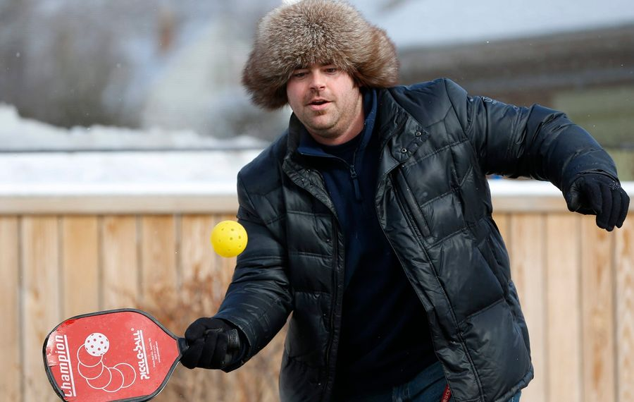 Beaux Hammond plays pickleball during a previous Larkinville Ice Festival. This year's festival takes place on Saturday. This year's festival also will include a twist on the Buffalo Groundhog Day beer bash at Flying Bison Brewing Company. (Derek Gee/ News file photo)