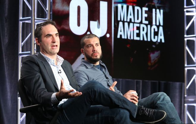 """ConnorSchell, left, senior vice president and executive producer, ESPN Films, and Ezra Edelman, director of """"OJ: Made In America,"""" discuss the documentary Tuesday in Pasadena, Calif."""