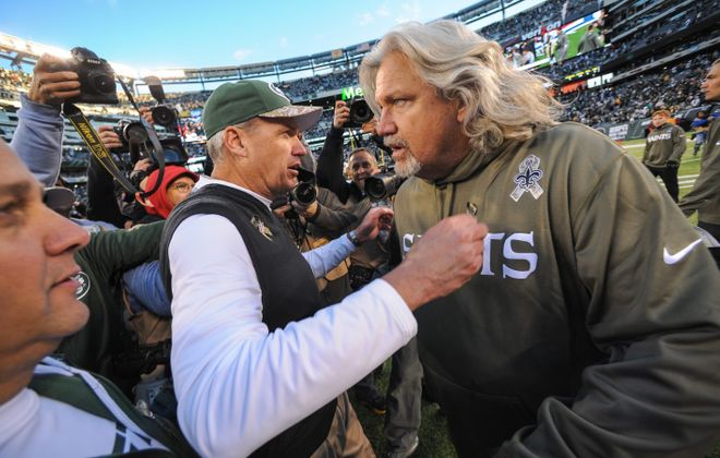 Then-head coach Rex Ryan of the New York Jets and then-defensive coordinator Rob Ryan of the New Orleans Saints hug at the end of the Jets 26-20 win at MetLife Stadium on November 3, 2013. (Getty Images)