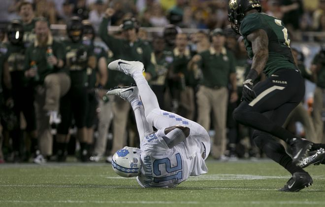 Baylor's Shawn Oakman stands over North Carolina quarterback Marquise Williams after sacking him during the Russell Athletic Bowl on Dec. 29 at the Orlando Citrus Bowl in Orlando, Fla. (Robert Willett/Raleigh News & Observer/TNS)