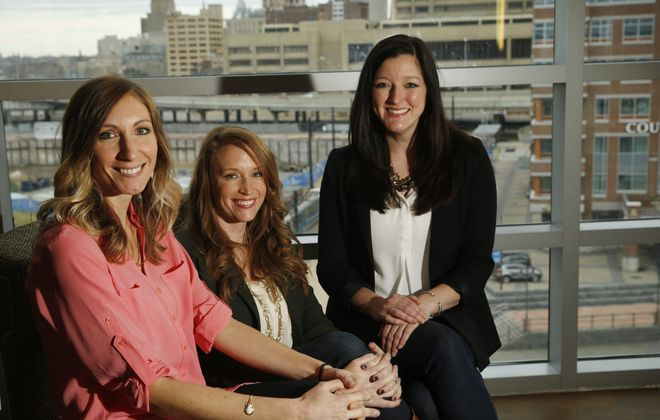 From left, lifelong friends Lisa Cavanagh, Kristin Lonergan and Andrea Bozek, who prefer Buffalo to other cities, await lunch at Panorama on 7 at the HarborCenter Marriott.