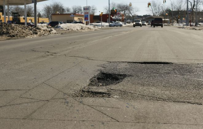 The poor condition of roads in the Buffalo area are to blame for the $1,873 a year Buffalo drivers spend making up for wear and tear on their vehicles, a Washington group said in a report released Thursday morning. (Derek Gee/Buffalo News)