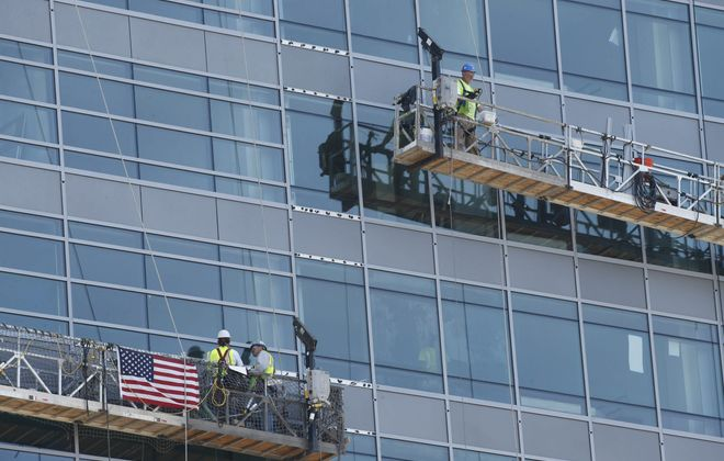 """Construction crews in lifts such as those operating on the exterior of  the HarborCenter tower last June are the types of workers covered by state's Scaffold Law, which is a subject of renewed debate amid long-standing tensions between unions and builders.  The safety group said OSHA inspectors found a violation in 83 percent of their area construction inspections, and 82 percent of the violations were classified as """"serious."""""""