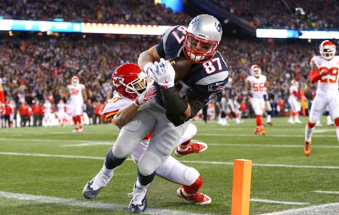 Rob Gronkowski scored twice in Saturday's win over Kansas City, including this third-quarter grab against the Chiefs'  Tyvon Branch.