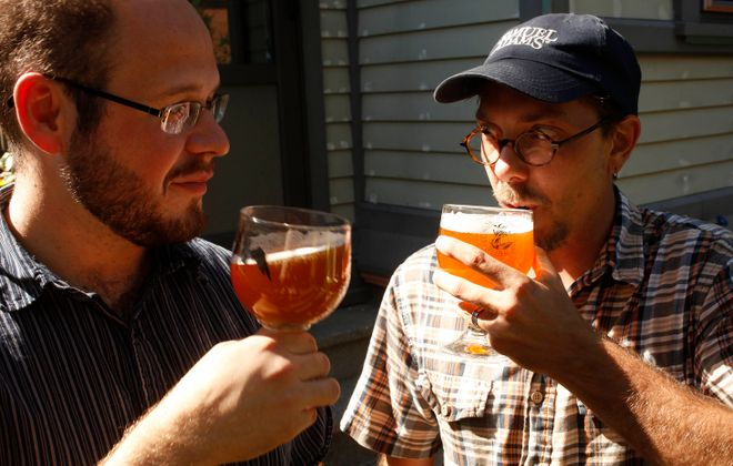 """Rudy Watkins, left, and Ethan Cox -- co-founders of Community Beer Works -- will collaborate with WNY Craft Beer Magazine on a """"Hoppy Hour"""" that features one variety of hop. (Derek Gee/Buffalo News file photo)"""
