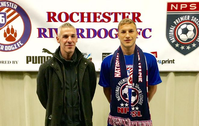Luke Pavone, right, stands next to Rochester River DogZ head coach Matt Tantalo after signing with the club. (via Rochester's Facebook page)