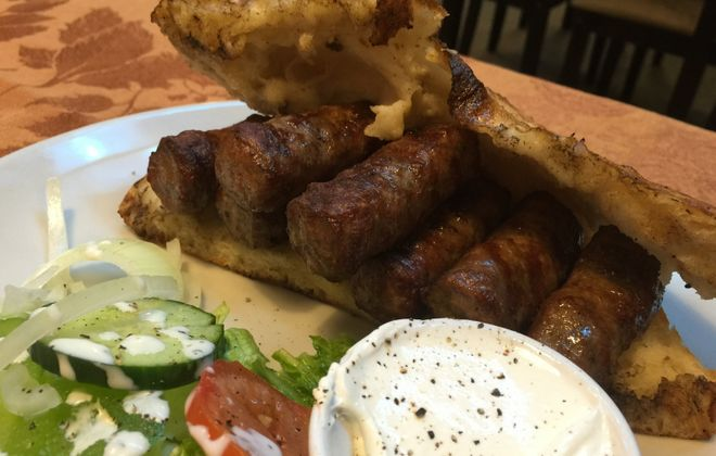 Cevapi, beef sausages served in housemade bread, are one of Balkan Dining's specialties. (Andrew Galarneau/Buffalo News)
