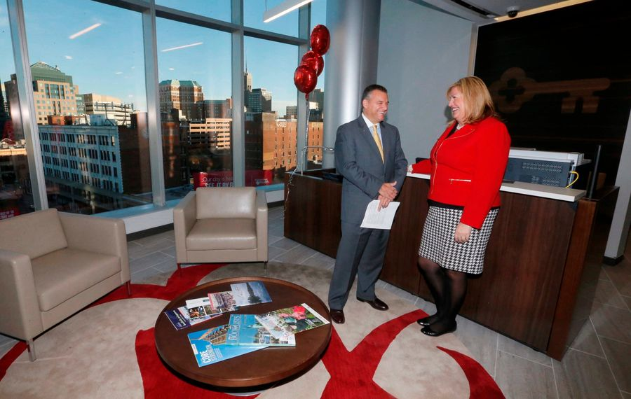 Gary D. Quenneville, KeyCorp's Buffalo market president and state region executive, meets with Sahron Lochocki, a regional retail leader, at the bank's new regional office space at 250 Delaware Ave.  in Buffalo (Robert Kirkham/Buffalo News)