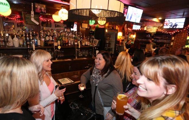 Jen Stepniak, Michelle Waltz, Jacki Patnella, Rose Duncan and Stacey Roach hang out at Brennan's Bowery Bar. (Sharon Cantillon/Buffalo News)