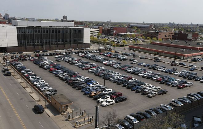 This parking lot on Ellicott Street is the proposed site of a grocer, apartments and an ECC annex.