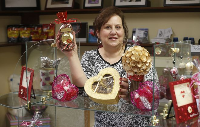 Mary Ann Hess of Honeymoon Sweets Gourmet Chocolates shows off some of her confections she makes at her shop on Porter Road in Niagara Falls.