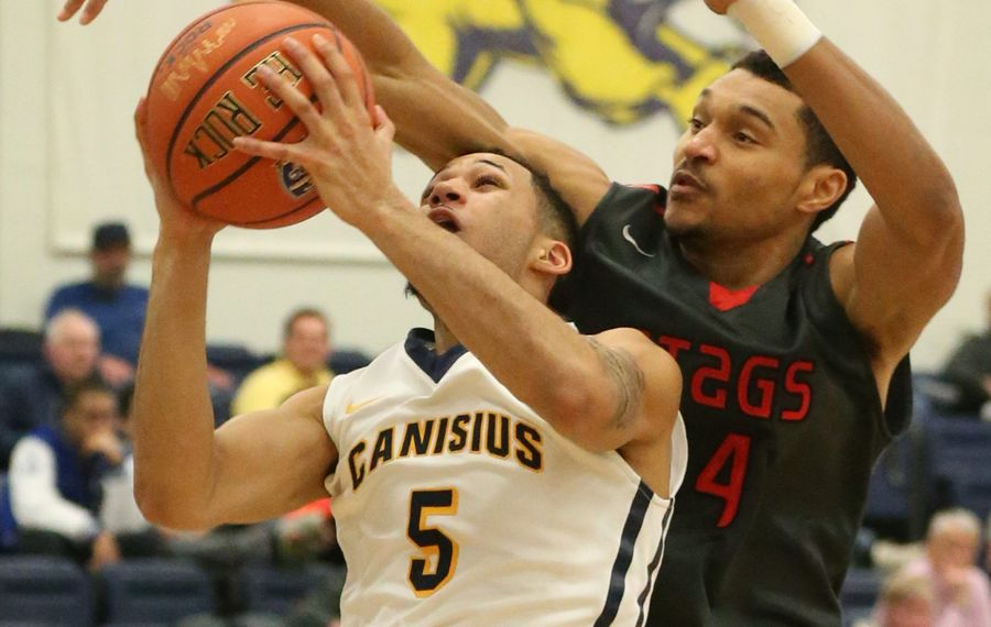 Canisius guard Kassius Robertson is fouled by Fairfield forward Marcus Gilbert in the second half of their game at Koessler Athletic Center. Fairfield won, 74-71.
