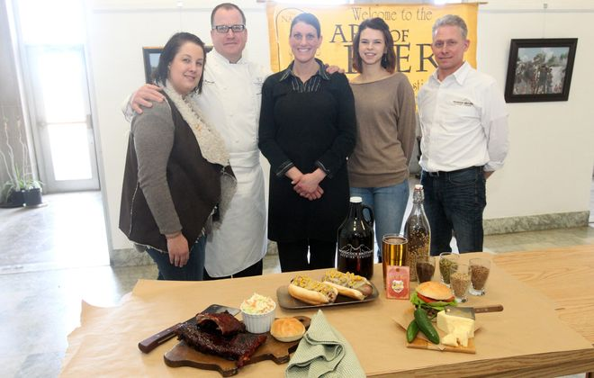From left, Claire Seveno of the Hard Rock Cafe, Frank and Rachel Dispenza from Dispenza's Meat Market, Erin Holody of Niagara Traditional Home Brew Supplier and Tim Woodcock of Woodcock Brothers Brewing will show their wares at the Art of Beer fundraiser for the Niagara Arts and Culinary Center. The event will be held Friday.