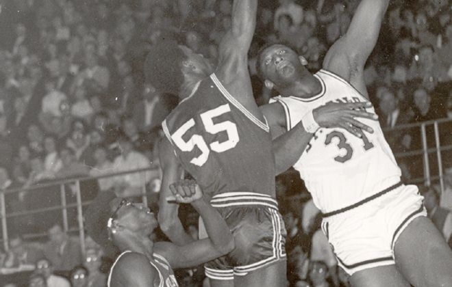 Playing for St. Bonaventure, Bob Lanier shoots one of the patented soft hook shots he developed at the Masten Boys Club.