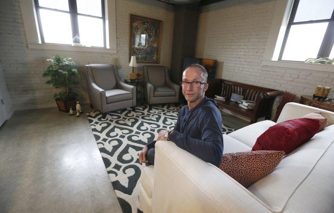 Tom Akers loves his apartment at the Fairmont Creamery on Scott Street in Buffalo. (Robert Kirkham/Buffalo News)