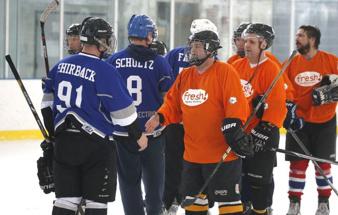 Teams shake hands after one of the many games played Saturday at the ninth annual Labatt Blue Buffalo Pond Hockey Tournament at the Buffalo RiverWorks entertainment complex.