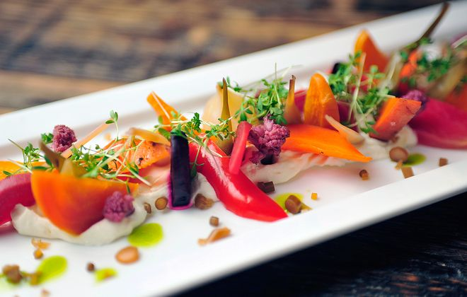 The Roasted and Pickled Vegetable Salad at CRaVing includes only ingredients from local farms. The veggies - beets, peppers, carrots, ramps, broccoli, kale and more - are all from Plato Dale Farm, and garlic scapes are from Arden Farm. (Michael P. Majewski)