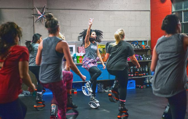 Kangoo Jumps, like those worn in this class at Garage Fitness in Angola, can reduce ground impact by up to 80 percent. (Michael P. Majewski)