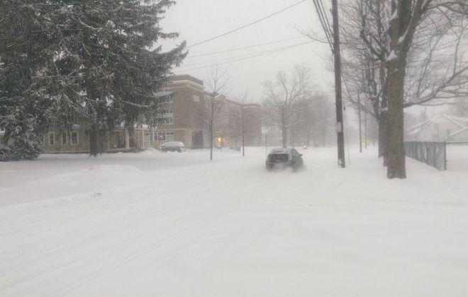 A snow-covered Hamburg street early Tuesday morning. (Geoff Nason/Buffalo News)