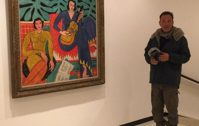 """Bruce Springsteen poses for a picture next to Henri Matisse's painting """"La Musique"""" on Friday afternoon."""