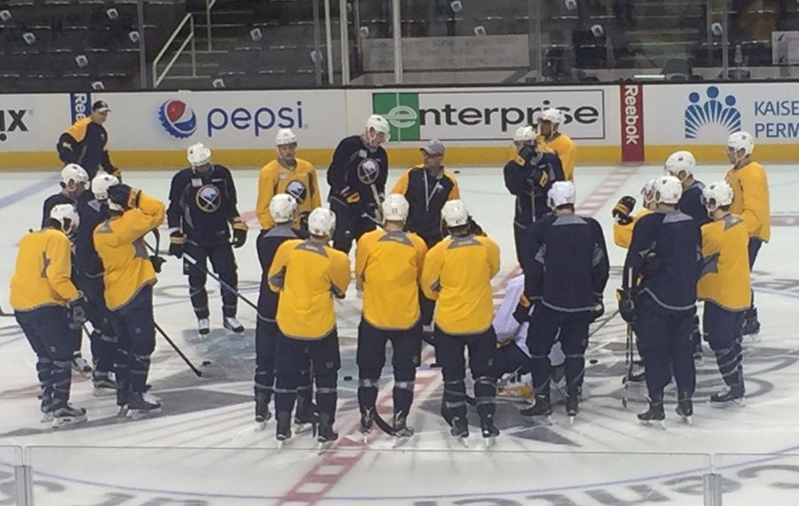 Sabres coach Dan Bylsma gathers his troops during today's morning skate in San Jose (Mike Harrington/Buffalo News).