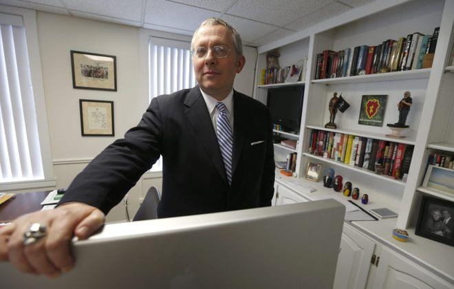 Republican political consultant Michael Caputo in his East Aurora office. (Robert Kirkham/News file photo)
