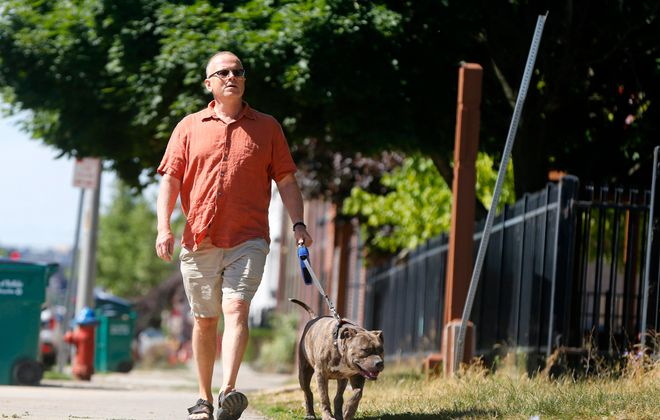 """Tom Higgins a volunteer dog walker takes """"Max"""" for a stroll at the Buffalo City Animal shelter Wednesday, June 22, 2016.    (Mark Mulville/Buffalo News)"""
