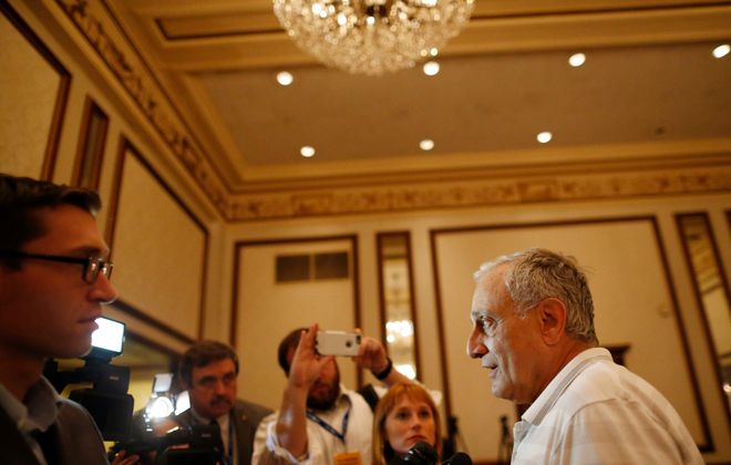 Carl Paladino does interviews with the media during the New York delegation breakfast at the Renaissance Hotel on July 20. (Derek Gee/Buffalo News)