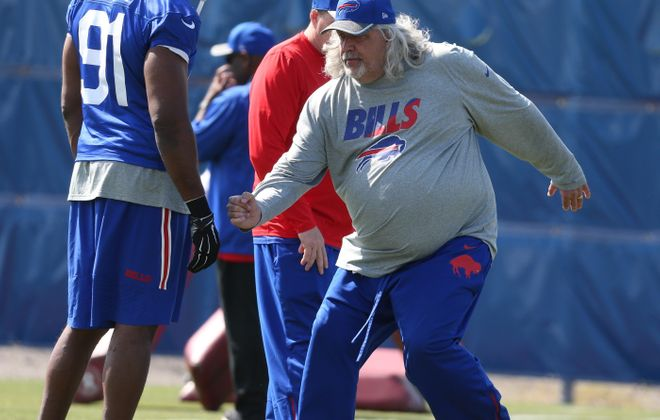 Bills linebacker Manny Lawson takes direction from assistant defensive coach Rob Ryan during organized team activities in the spring.