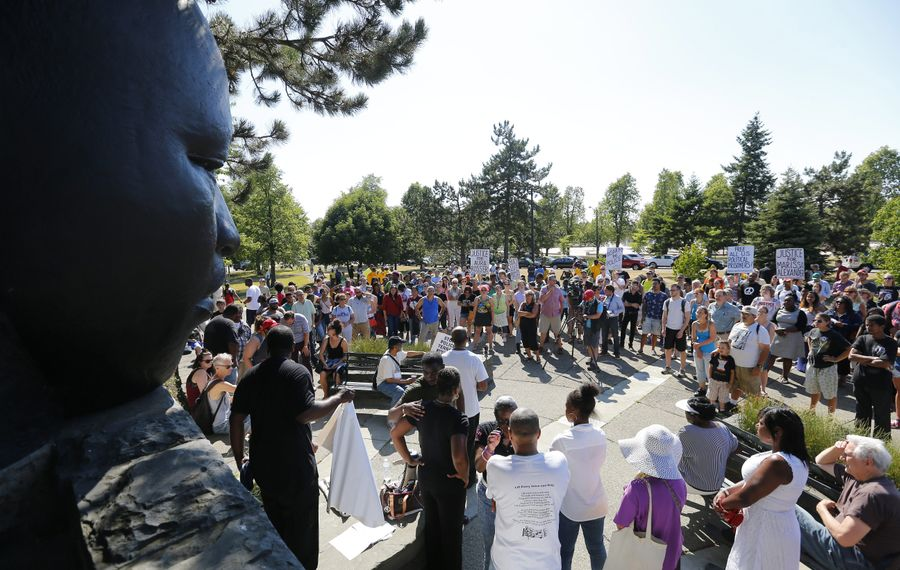 People gather in Martin Luther King Park for a Black Lives Matter rally in Buffalo Friday. The event was organized by Power in Numbers, an area advocacy group.